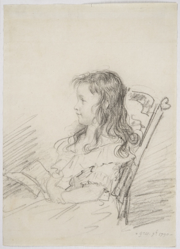 Portrait of a young girl, sitting in a chair with a book in her hand